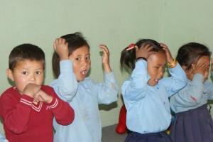 Kinderen tijdens gezondhedsvoorlichting op school